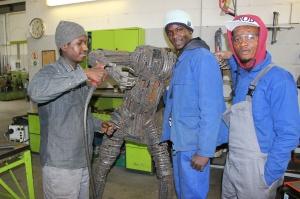 Drei Flüchtlinge im Handwerksbetrieb